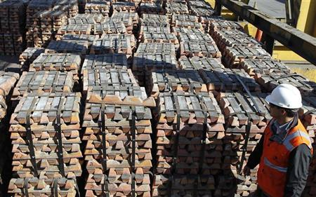 A worker checks a shipment of copper inside the plant at the copper refinery of Codelco Ventanas in Ventanas city, about 164 km (101 miles) northwest of Santiago, April 16, 2012. REUTERS/Eliseo Fernandez