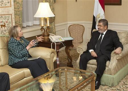 U.S. Secretary of State Hillary Clinton meets with Egyptian President Mohamed Mursi on the sidelines of the United Nations General Assembly in New York September 24, 2012. REUTERS/Andrew Kelly