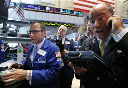 Traders work on the floor of the New York Stock Exchange, July 10, 2012. REUTERS/Brendan McDermid