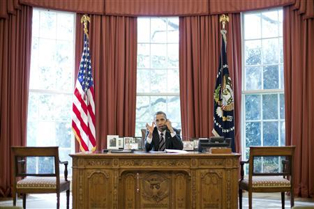 U.S. President Barack Obama speaks on the phone with Israel's Prime Minister Benjamin Netanyahu, in the Oval Office in this September 28, 2012 White House handout photograph. REUTERS/Pete Souza/The White House/Handout