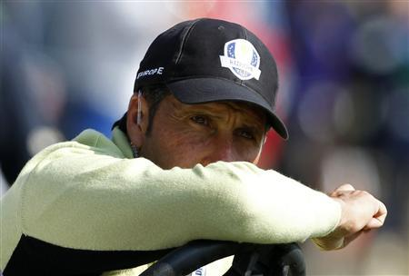Team Europe captain Jose Maria Olazabal of Spain watches play on the eighth green during the afternoon four-ball round at the 39th Ryder Cup matches at the Medinah Country Club in Medinah, Illinois, September 28, 2012. REUTERS/Matt Sullivan