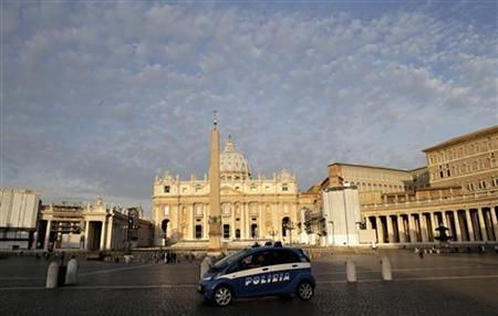 An Italian police car patrols Saint Peter's square during the opening day of the trial for Pope Benedict's former butler, Paolo Gabriele, at the Vatican September 29, 2012. REUTERS/Tony Gentile