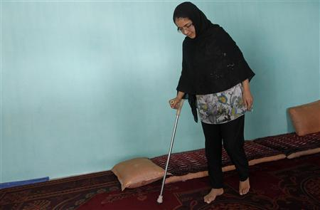 Muzhgan Masoomi, 22, walks in her house in Kabul August 28, 2012. REUTERS/Omar Sobhani