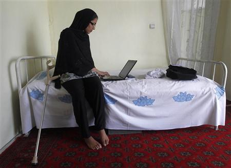 Muzhgan Masoomi, 22, works on her laptop at a house in Kabul August 28, 2012. REUTERS/Omar Sobhani