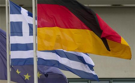 European, Greek and German flags fly outside the Chancellery in Berlin, August 24, 2012. REUTERS/Thomas Peter