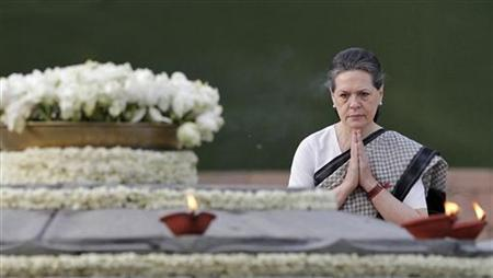 Ruling Congress party chief Sonia Gandhi pays tribute at her husband Rajiv Gandhi's memorial on the 21st anniversary of the former Prime Minister's death in New Delhi May 21, 2012. REUTERS/Adnan Abidi/Files