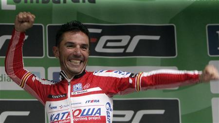 Katusha rider Joaquim ''Purito'' Rodriguez of Spain celebrates on the podium after winning the 251 km (156 miles) Tour of Lombardy (Giro di Lombardia) classic cycling race from Bergamo to Lecco September 29, 2012. REUTERS/Stringer