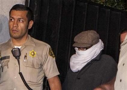 Nakoula Basseley Nakoula (R) is escorted out of his home by Los Angeles County Sheriff's officers in Cerritos, California in this file photo taken September 15, 2012. REUTERS/Bret Hartman/Files