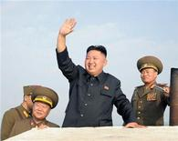North Korean leader Kim Jong-Un (C) waves as he visits military units on islands in the most southwest of Pyongyang in this picture released by the North's official KCNA news agency in Pyongyang August 19, 2012. REUTERS/KCNA