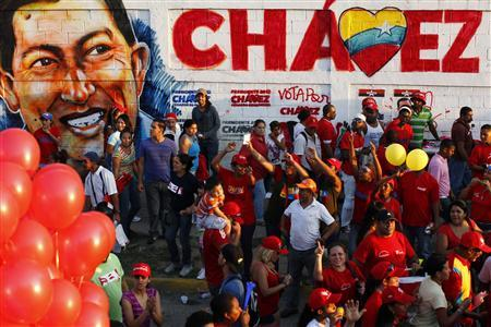 People attend a campaign rally by Venezuela's President Hugo Chavez, who is seeking re-election in an October 7 presidential vote, in Guarenas in the state of Miranda September 29, 2012. REUTERS/Jorge Silva