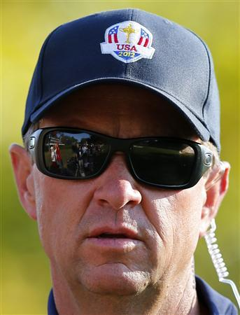 The golf course is reflected in the sunglasses of U.S. captain Davis Love III as he walks along the 11th fairway during the afternoon four-ball round at the 39th Ryder Cup golf matches at the Medinah Country Club in Medinah, Illinois September 29, 2012. REUTERS/Mike Blake