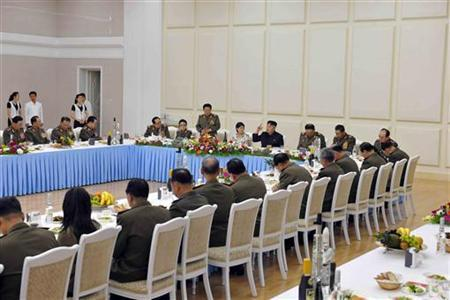 North Korean leader Kim Jong-Un (C) speaks at a banquet to celebrate the 52nd anniversary of the start of the late leader Kim Jong-il's leadership over the Songun (military first) in this picture released by the North's official KCNA news agency in Pyongyang August 26, 2012. REUTERS/KCNA