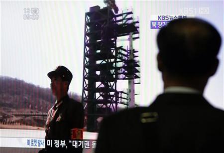 A South Korean passenger looks at a TV report on North Korea's rocket launch at Seoul railway station in Seoul April 13, 2012. REUTERS/Kim Hong-Ji/Files