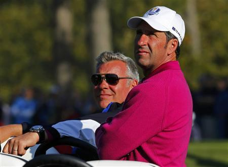 Team Europe captain Jose Maria Olazabal (R) of Spain watches play in the sixth hole with vice captain Darren Clarke of Northern Ireland during the morning foursomes round at the 39th Ryder Cup golf matches at the Medinah Country Club in Medinah, Illinois September 29, 2012. REUTERS/Mike Blake