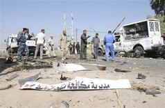 <p>موقع تفجير في الكوت جنوبي بغداد يوم الاحد - رويترز</p>