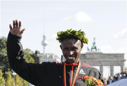 Geoffrey Mutai of Kenya reacts winning in the 39th Berlin Marathon in Berlin, September 30, 2012. REUTERS/Tobias Schwarz
