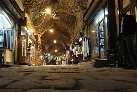 People walk through the Al-Madina Souq market in Aleppo in this March 3, 2011 file photo. REUTERS/Fabian Bimmer/Files