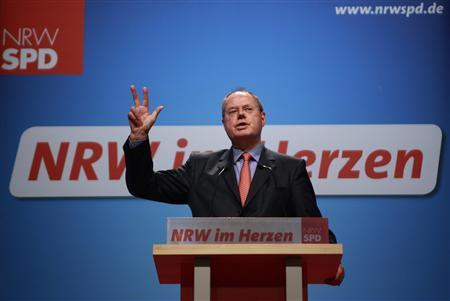 Former German Finance Minister and Social Democrat (SPD) member Peer Steinbrueck addresses a speech during a North Rhine-Westphalia SPD party convention in the western German city of Muenster September 29, 2012. REUTERS/Ina Fassbender