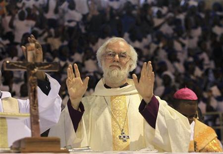 Head of Anglican Church, Archibishop of Canterbury Rowan Williams, greets people upon his arrival in a church service in the capital Harare, October 9, 2011. REUTERS/Philimon Bulawayo