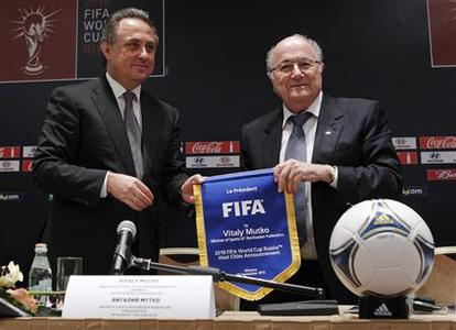 FIFA president Sepp Blatter (R) and Russian Sports Minister Vitaly Mutko attend a news conference in Moscow September 30, 2012. REUTERS/Maxim Shemetov