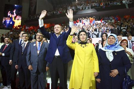 Turkey's Prime Minister and leader of ruling Justice and Development Party (AKP) Tayyip Erdogan (C), accompanied by his wife Emine Erdogan (front 2nd R), greets his supporters as he enters the hall during his party congress in Ankara September 30, 2012. REUTERS-Adem Altan-Pool