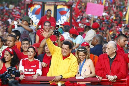 Venezuela's President Hugo Chavez waves at supporters during a campaign rally in Guarenas in the state of Miranda September 29, 2012. Chavez is seeking re-election in an October 7 presidential vote. REUTERS/Jorge Silva