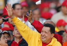 Venezuela's President Hugo Chavez waves at supporters during a campaign rally in Guarenas in the state of Miranda September 29, 2012. REUTERS/Jorge Silva