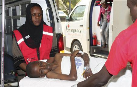 Kenya Red Cross personnel assist a child injured during an explosion at the Anglican Church of Kenya (ACK) Sunday school along Juja Road in the Kenyan capital Nairobi, September 30, 2012. REUTERS/Gazelle Johnathan