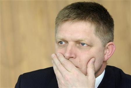 Robert Fico gestures during an interview with Reuters in Bratislava March 21, 2012. REUTERS/Radovan Stoklasa
