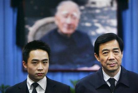 China's former Chongqing Municipality Communist Party Secretary Bo Xilai (R) and his son Bo Guagua stand in front of a picture of his father Bo Yibo, former vice-chairman of the Central Advisory Commission of the Communist Party of China, at a mourning hall in Beijing in this January 18, 2007 file photo. Bo Guagua, the Harvard-educated son of disgraced Chinese political leader Bo Xilai, defended his father against charges of taking bribes and having improper sexual relationships, saying he believed in his father's good character, in a statement posted on the microblog site Tumblr on September 29, 2012. REUTERS/Stringer/Files