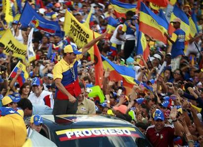 Venezuela's opposition presidential candidate Henrique Capriles waves to supporters as he arrives at a regional closing campaign rally in Caracas September 30, 2012. REUTERS/Stringer