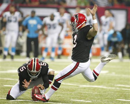 Atlanta Falcons holder Matt Bosher holds the ball as kicker Matt Bryant (2), kicks the winning field goal against the Carolina Panthers in the second half of their NFL football game in Atlanta, Georgia September 30, 2012. REUTERS/Tami Chappell