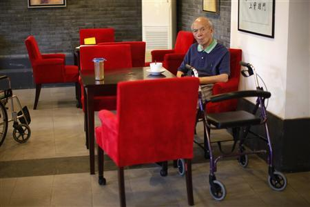 An elderly man sits at the cafeteria of the Cherish-Yearn care center facility in Shanghai September 14, 2012. REUTERS/Carlos Barria