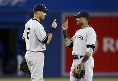 New York Yankees Derek Jeter (L) and Robinson Cano celebrate defeating the Toronto Blue Jays after their MLB American League baseball game in Toronto, September 30, 2012. REUTERS/Mark Blinch