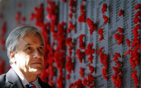 President of Chile, Sebastian Pinera, inspects a wall covered with the names of fallen Australian soldiers as he tours the Australian War Memorial in Canberra September 11, 2012. REUTERS/Tim Wimborne