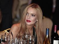 Actress Lindsay Lohan attends the White House Correspondents Association annual dinner in Washington in this April 28, 2012 file photograph. Lohan was attacked by a man in a New York hotel on September 30, 2012, her spokesman said, in what media reports described as a scuffle over her demands that photos of her be deleted from his cellphone. Lohan suffered minor injures following the Sunday morning attack, spokesman Steve Honig said in a statement. REUTERS/Larry Downing/Files