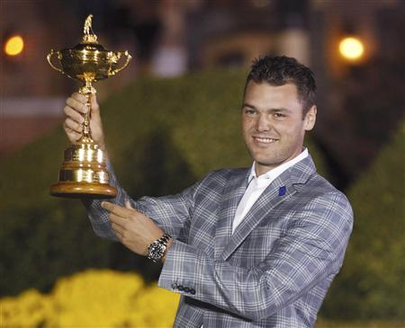 Team Europe golfer Martin Kaymer of Germany holds the Ryder Cup as he poses after the closing ceremony of the 39th Ryder Cup at the Medinah Country Club in Medinah, Illinois, September 30, 2012. REUTERS/Jeff Haynes