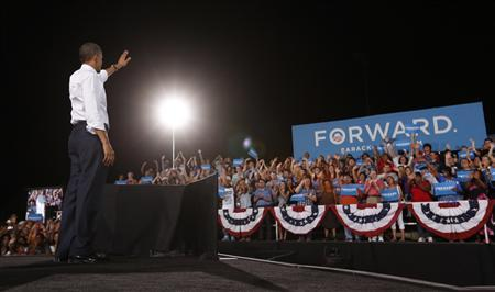 U.S. President Barack Obama waves to supporters during a campaign rally at Desert Pines High School in Las Vegas, Nevada September 30, 2012. REUTERS/Kevin Lamarque