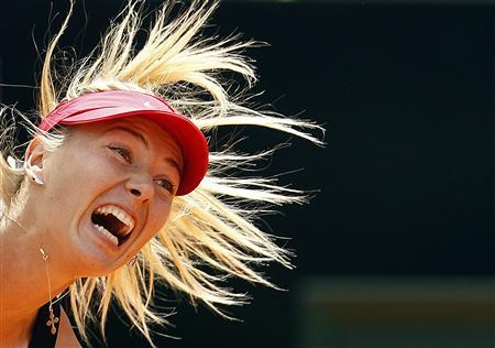 Maria Sharapova of Russia serves to Angelique Kerber of Germany during their women's singles semi-final match at the Rome Masters tennis tournament in this May 19, 2012 file photo. Plans to muzzle the ear-bashing grunters of women's tennis have found an unlikely ally in Sharapova. One of the worst offenders, her screams have been measured at more than 101 decibels - comparable to a chain saw, a pneumatic drill or a speeding train. The sport's governing body is to educate players to turn down the volume after pressure from fans, TV broadcasters and a handful of competitors fed up with the constant shrieking on court - and Sharapova thinks it is the right answer. REUTERS/Alessandro Bianchi/Files