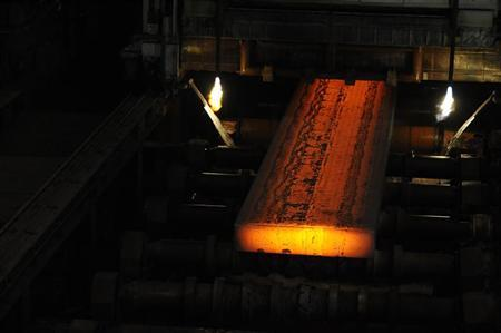 A finished steel slab comes off the roller table at SSI steel plant at Redcar, northern England May 29, 2012. REUTERS/Nigel Roddis