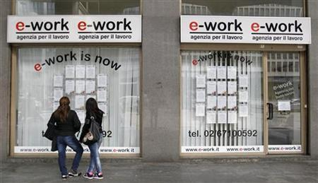 People check job offers outside a recruitment agency in downtown Milan April 3, 2012. REUTERS/Alessandro Garofalo