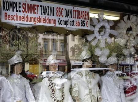 Clothes traditionally worn by Muslim boys before their circumcisions, are displayed in the window of the ''Kids Elegance'' store in Berlin's Neukoelln district, September 28, 2012. REUTERS/Tobias Schwarz