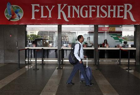 A passenger walks past a near-empty Kingfisher airlines ticketing office at Mumbai's domestic airport in this March 27, 2012 file photo. Kingfisher Airlines said it would cancel several flights on October 1, 2012 due to employee unrest, the company said in a statement without providing details of the cancellations. REUTERS/Vivek Prakash/Files