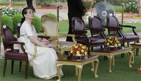 Chief of India's ruling Congress party Sonia Gandhi waits for the start of the ''At-Home Ceremony'' to mark India's Independence Day at India's presidential palace Rashtrapati Bhavan in New Delhi August 15, 2012. REUTERS/B Mathur/Files
