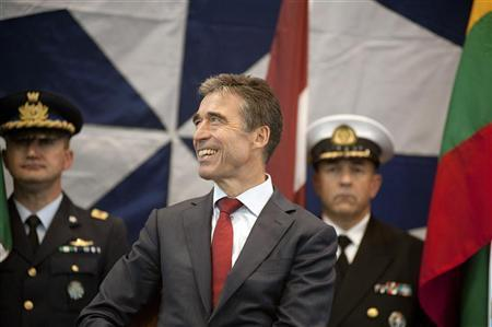 Secretary General of NATO Anders Fogh Rasmussen (C) smiles during a Change of Command Ceremony in which French Air Force General Stephane Abrial relinquished command to French Air Force General Jean-Paul Palomeros as NATO's Supreme Allied Commander Transformation in Norfolk, Virginia September 28, 2012. REUTERS/Rich-Joseph Facun