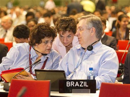 United Nations (UN) Framework Convention on Climate Change Executive Secretary Christiana Figueres speaks with Brazil's Minister of Environment Izabella Teixeira (L) and chief climate envoy Luiz alberto Figueiredo during a plenary session at the United Nations Climate Change Conference (COP17) in Durban December 10, 2011. REUTERS/Rogan Ward