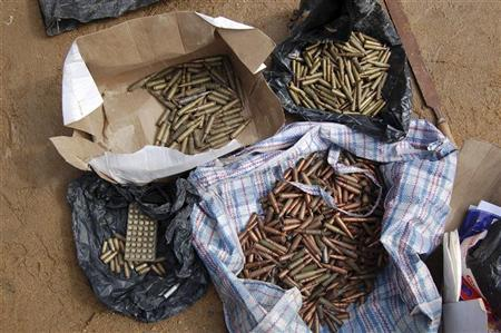 Confiscated ammunitions are displayed after a military raid on a hideout of suspected Islamist Boko Haram members in Nigeria's northern city of Kano August 11, 2012. REUTERS/Stringer