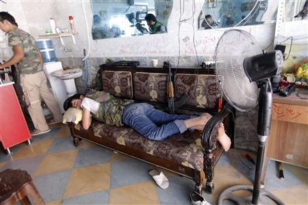 A Free Syrian Army fighter rests in a shop in Aleppo's al-Zebdieh district October 1, 2012. REUTERS/Zain Karam