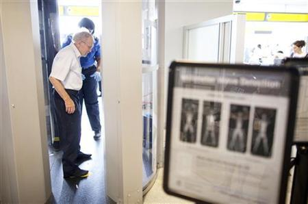 A man receives instructions on going through a full body scanner at a Transportation Security Administration security checkpoint in the Newark Liberty International Airport in Newark, New Jersey July 28, 2011. REUTERS/Lucas Jackson