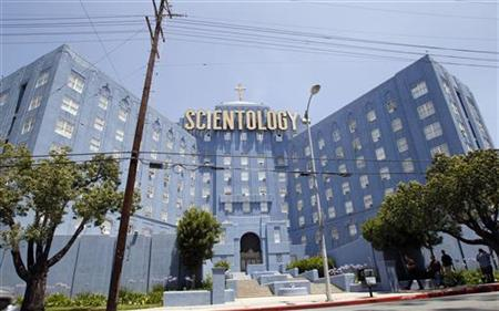 People walk past the Church of Scientology of Los Angeles building in Los Angeles, California July 3, 2012. REUTERS/Mario Anzuoni